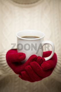 Woman in Sweater with Red Mittens Holding Cup of Coffee