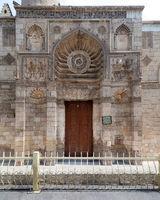 Entrance of Fatimid era Aqmar Mosque, with lavish decoration across the entire facade, Muizz Street, Cairo, Egypt