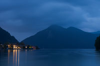 The village Walchensee on the lake Walchensee at night with mountains in background