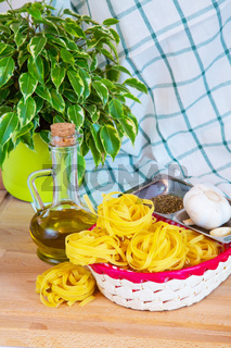 Tagliatelle, garlic and olive oil prepared for cooking