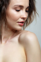Beautiful young woman portrait with natural nude makeup.