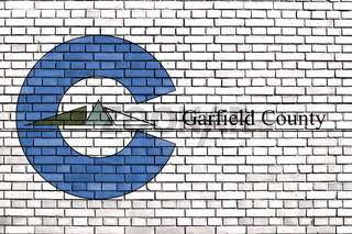 flag of Garfield County, Colorado painted on brick wall