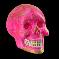 Typical Mexican skull painted isolated on black background. Dia de los muertos. Creative and minimal Day of the Dead or Halloween layout. Skull pink