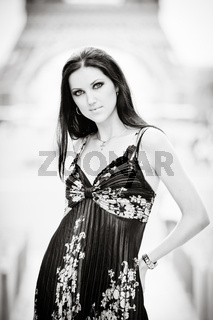 Beautiful woman with Eiffel Tower on the background.