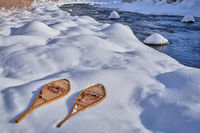 classic wooden snowshoes in mountains