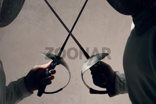 Fencer with fencing sword. Fencers duel concept