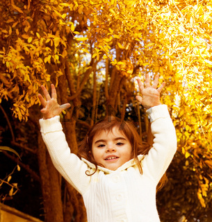 Small girl in autumn forest