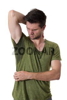 Man sweating very badly under armpit and pointing there