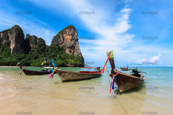 Long tail boats on tropical beach
