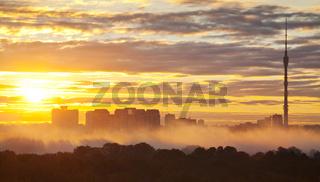 yellow sunrise in autumn city