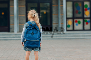 Cute little girl with backpack going back to school