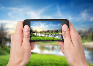 Phone and spring landscape