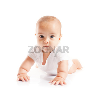 Cute baby boy is learning to craw, isolated
