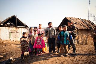 SEREDNIE, UKRAINE - MARCH 09, 2011: children living in a small poor village