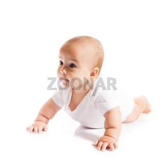 Adorable crawling baby boy looking aside on white