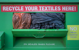 Overflowing Textile Recycling Bin