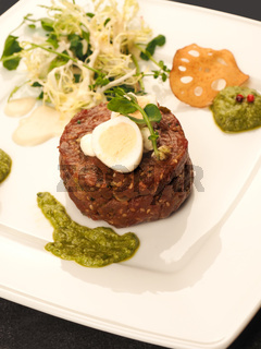Beef tartare with a quail egg and fresh organic garden salad