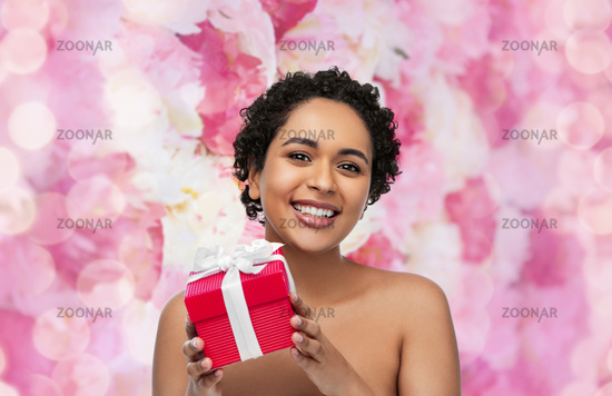 portrait of young african american woman with gift