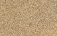 Detailed texture of golden glitter dust surface