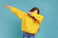 Little girl making dabbing movement, famous internet meme of success victory, following trends.