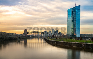 frankfurt skyline at sunset with colorful reflections in the main river, frankfurt am main, germany