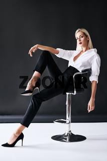 Full length portrait of daring trendy woman posing on black studio background.