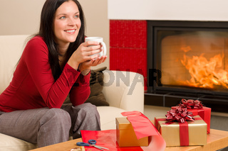 Christmas present wrap woman drink home fireplace