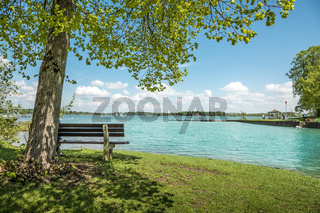 Lake Chiemsee with tree and bench