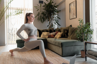 Healthy sport lifestyle concept, blogger girl doing sport exercises at home