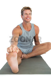 Man working out and stretching his leg