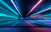 Highspeed underground drive - colorful concept for racing though the night and overtake another car in a tunnel with motion blur effect.