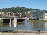 Nibelungen Bridge, New City Hall, and Ars Electronica Center with Pöstlingberg and Sieben Schmmerzen Marias Church in the Background