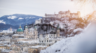 Panorama of Salzburg in winter: Snowy historical center and old city, sunshine