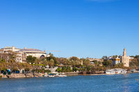 Seville City Skyline From Guadalquivir River In Spain