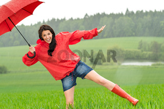 Playful happy girl in the rain