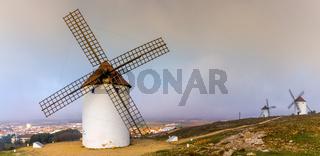 View of historic whitewashed windmills in La Mancha