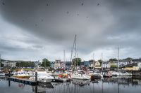Yachts and sailboats moored in small, beautiful marina in Ballycastle town