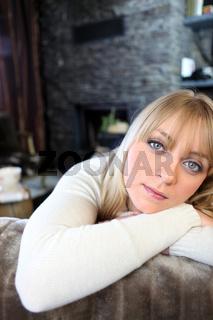 Woman relaxing in her cozy living room