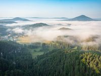 Morning view to misty Swiss Bohemian landscape during sunrise. Morning mist