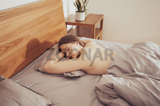 Woman felt asleep while long reading in bed