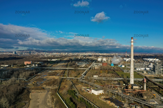 Oil refinery in construction near a large city from drone
