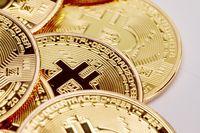 Many bitcoin coins close up