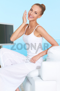 Graceful woman in white outfit