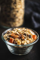 Beakfast cereals in bowl. Healthy muesli with oat flakes, nuts and raisins