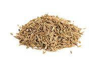 Pile of Cumin seeds isolated on white background. Cuminum cyminum