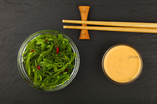 Green wakame seaweed salad with satay sauce