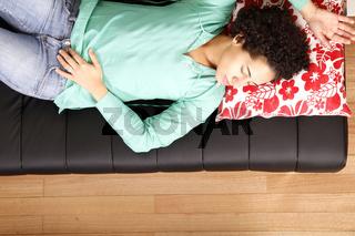 Jung brazilian woman sleeping on the sofa