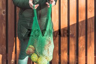 Zero waste lifestyle. Stylish blue mesh shopping bag