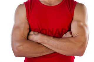 Midsection of sports player with arms crossed