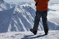 Skier on top of snowy mountain in nice winter day